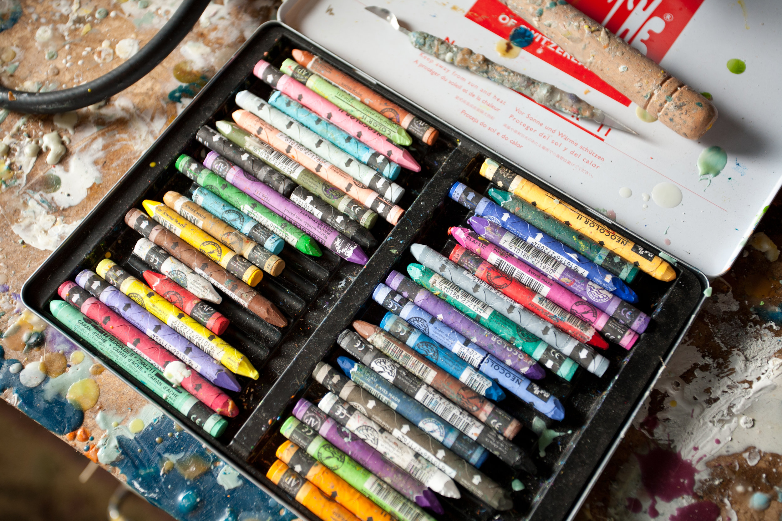 The fine scribbly detail you see in my paintings are made with these wax pastels.
