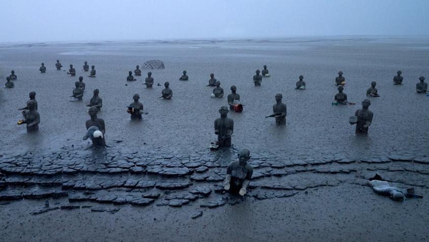 Statues-in-Rain-Wide.jpg