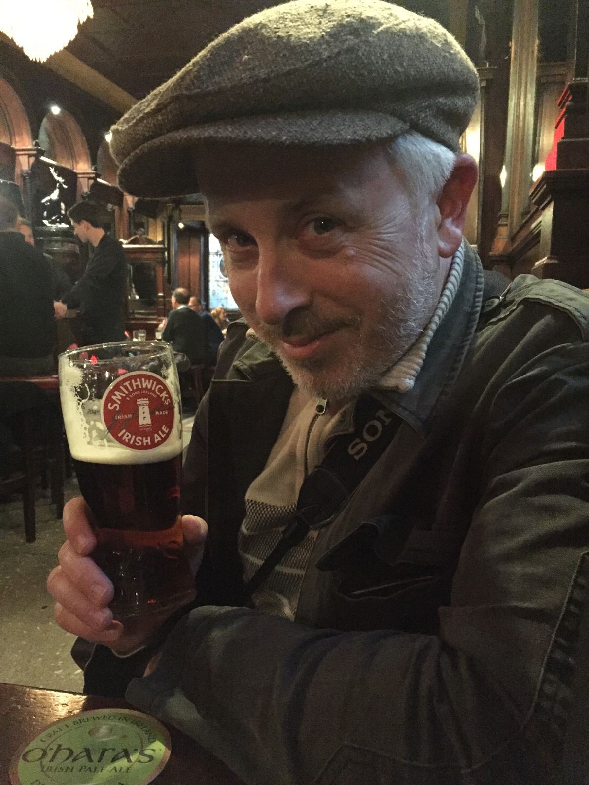 Enjoying a pint at the Stag's Head in Dublin, Ireland - May 2017