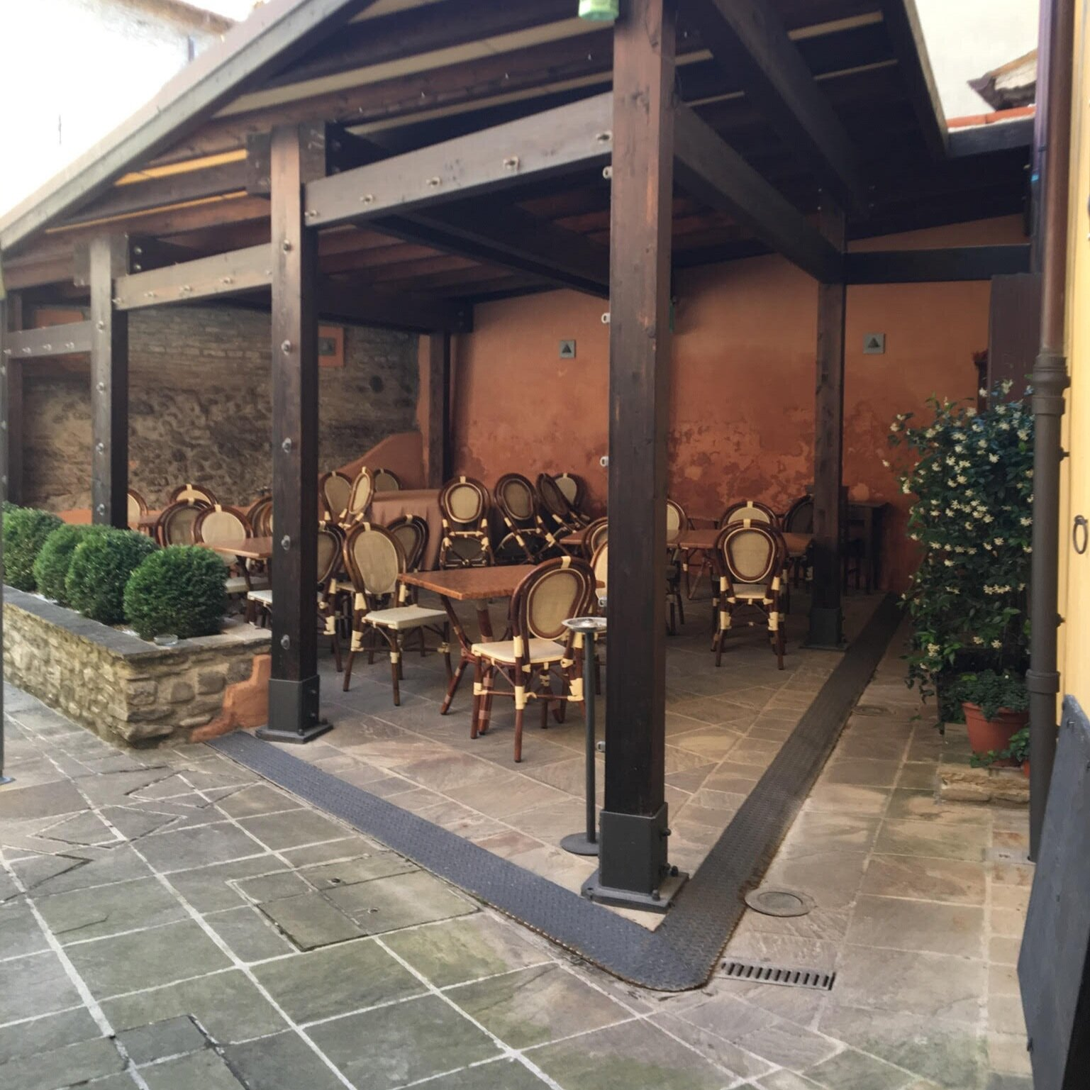 The hotel restaurant patio where guests can enjoy a cup of coffee, breakfast, and dinner.