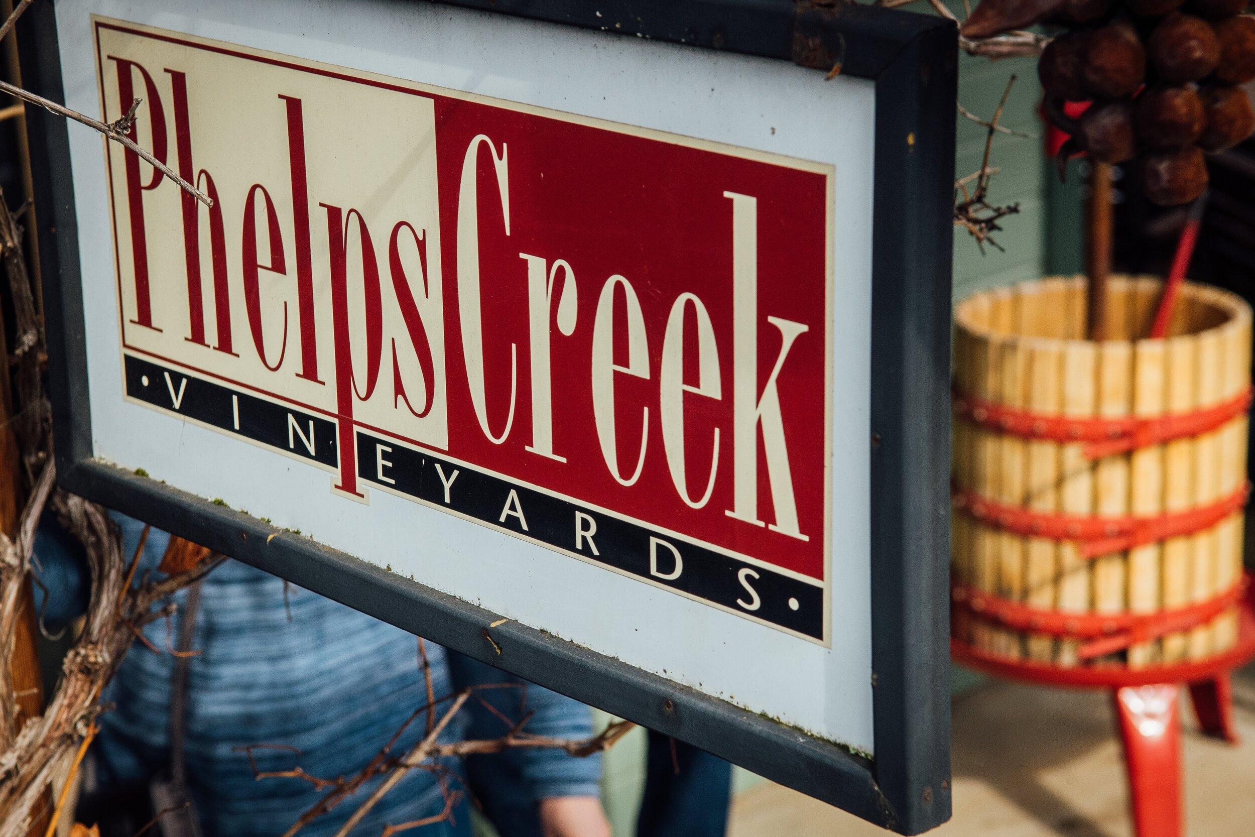 """Image of Tasting Room Sign """"Phelps Creek Vineyards"""""""