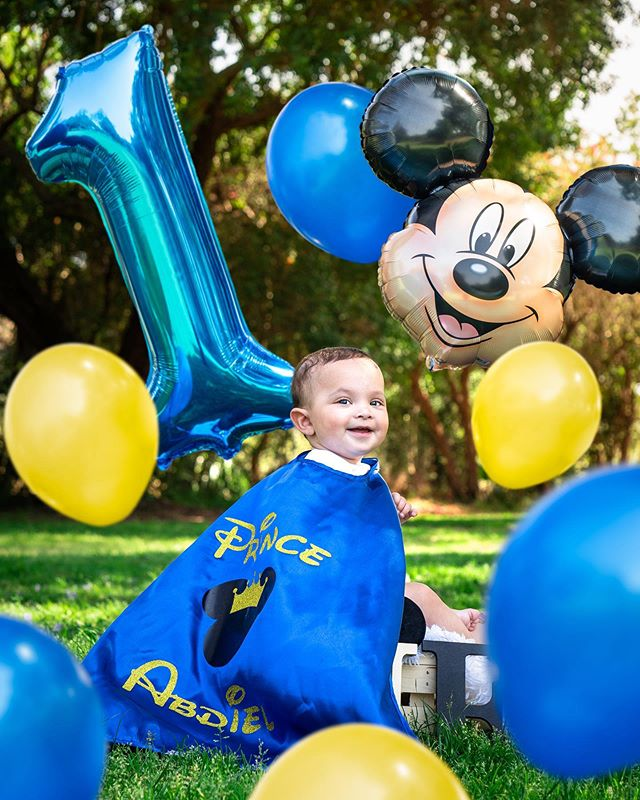 Cuteness Overload!   #cute #blue #cape #mickey #mickeymouse #disney #disneybabies #prince #balloons #yellow #green #grass #photography #photo #baby #infant #photoshoot #summer #day #sunny #1 #birthday #happy