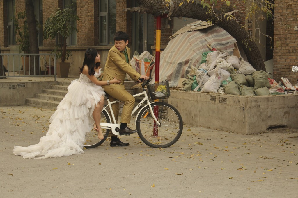 FYI: Chinese Wedding Photography is THE BEST! Note the trash pile. # Romance