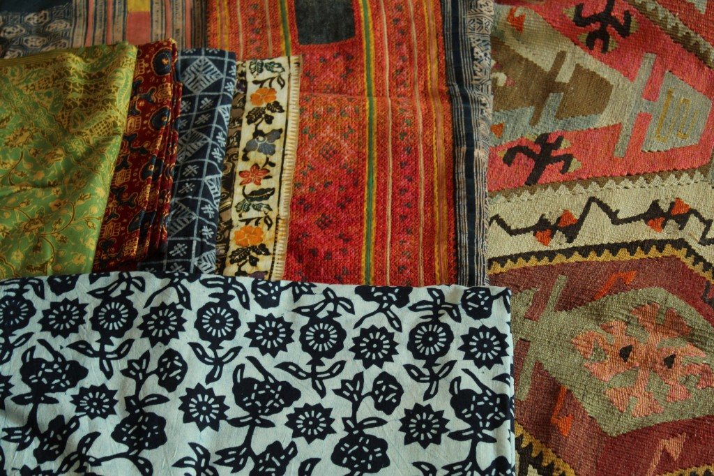 Fabrics from all over....just waiting to be used.