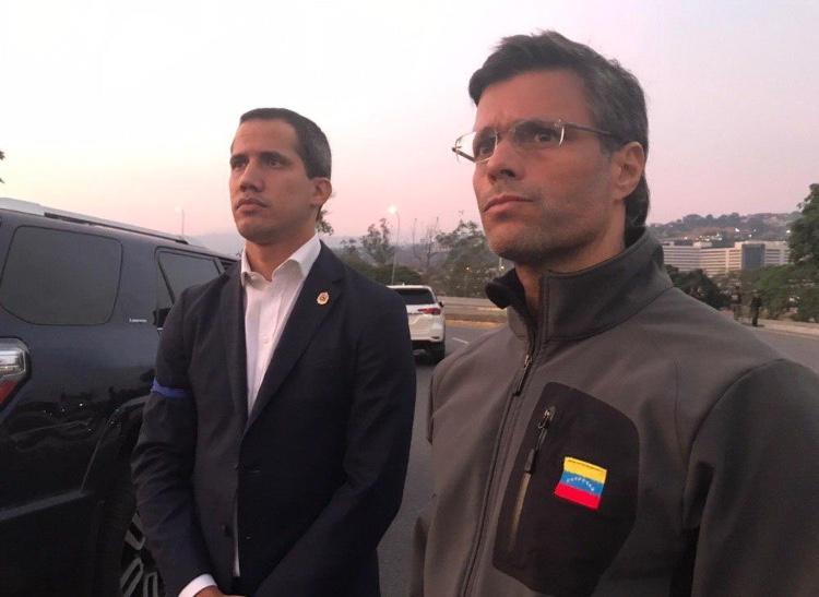 Juan Guaido and Leopoldo Lopez standing outside La Carlota airbase on the morning of the 30th April