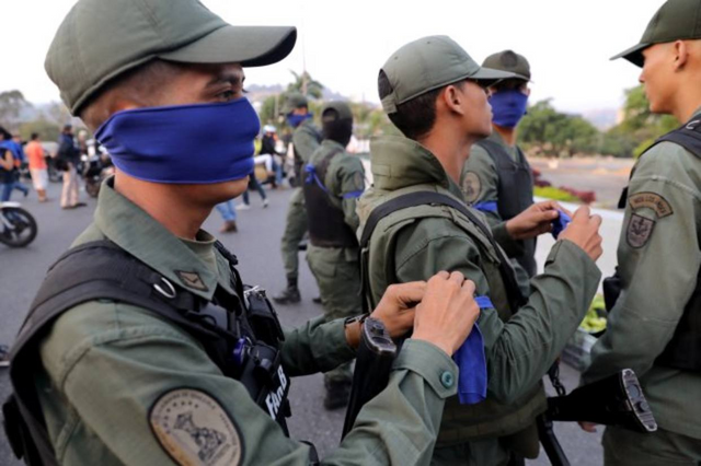 Venezuelan soldiers of the National Guard supporting Guaido outside La Carlota airbase in April 30th