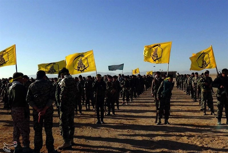 Liwa Fatemiyoun fighters during the Palmyra offensive (December 2016), showcasing their flag.