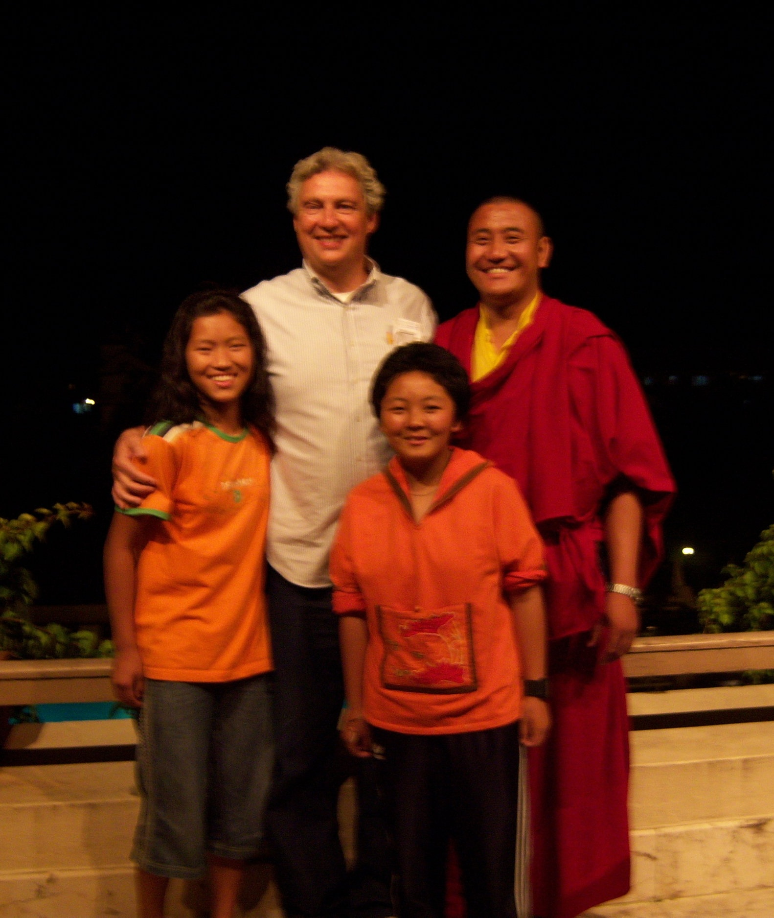 David pictured with friends in Kathmandu. He traveled to visit schools and work with children.