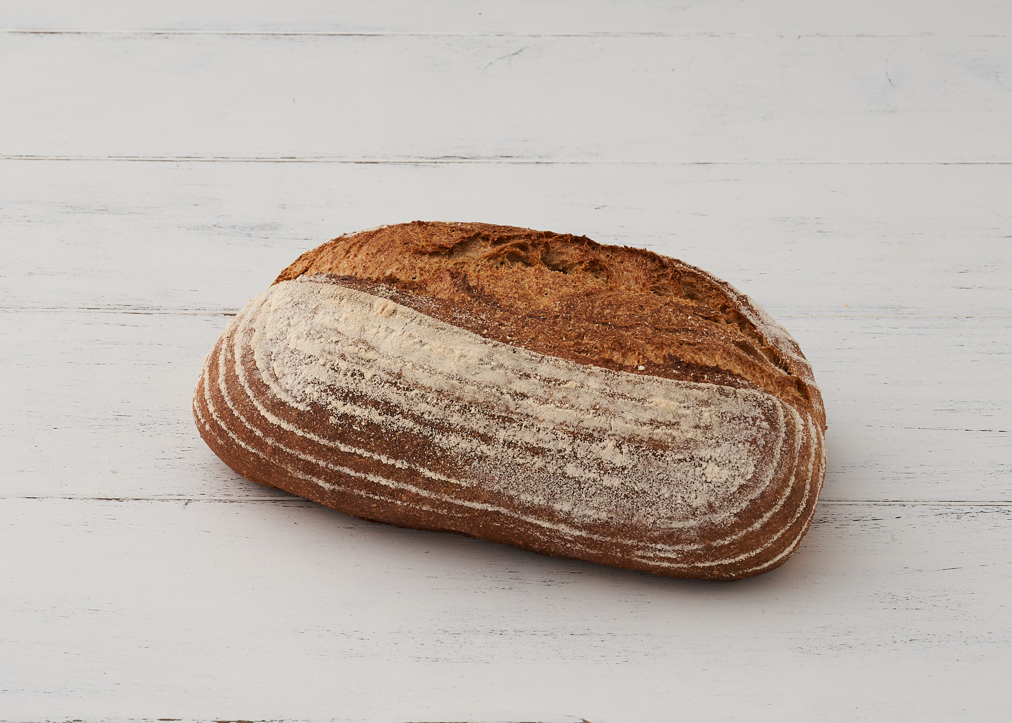 Sourdough - Our long fermented Sourdough combines White, wholemeal and rye flours with our rye sourdough starter to create a rustic loaf with a lovely sour flavour