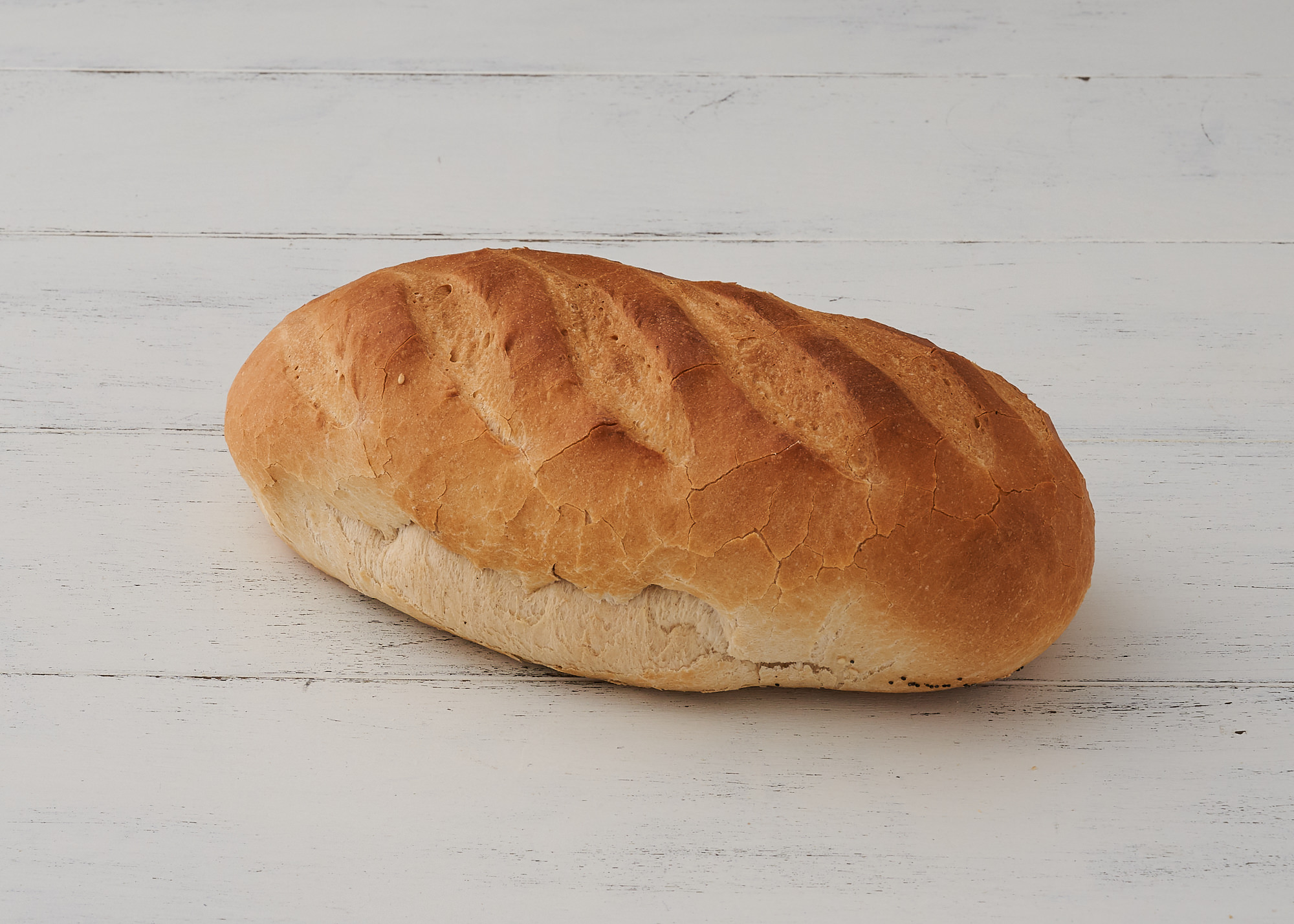 White Bloomer - A classic traditional British Loaf developed during the war. It has 7 cuts allowing for a slice each day