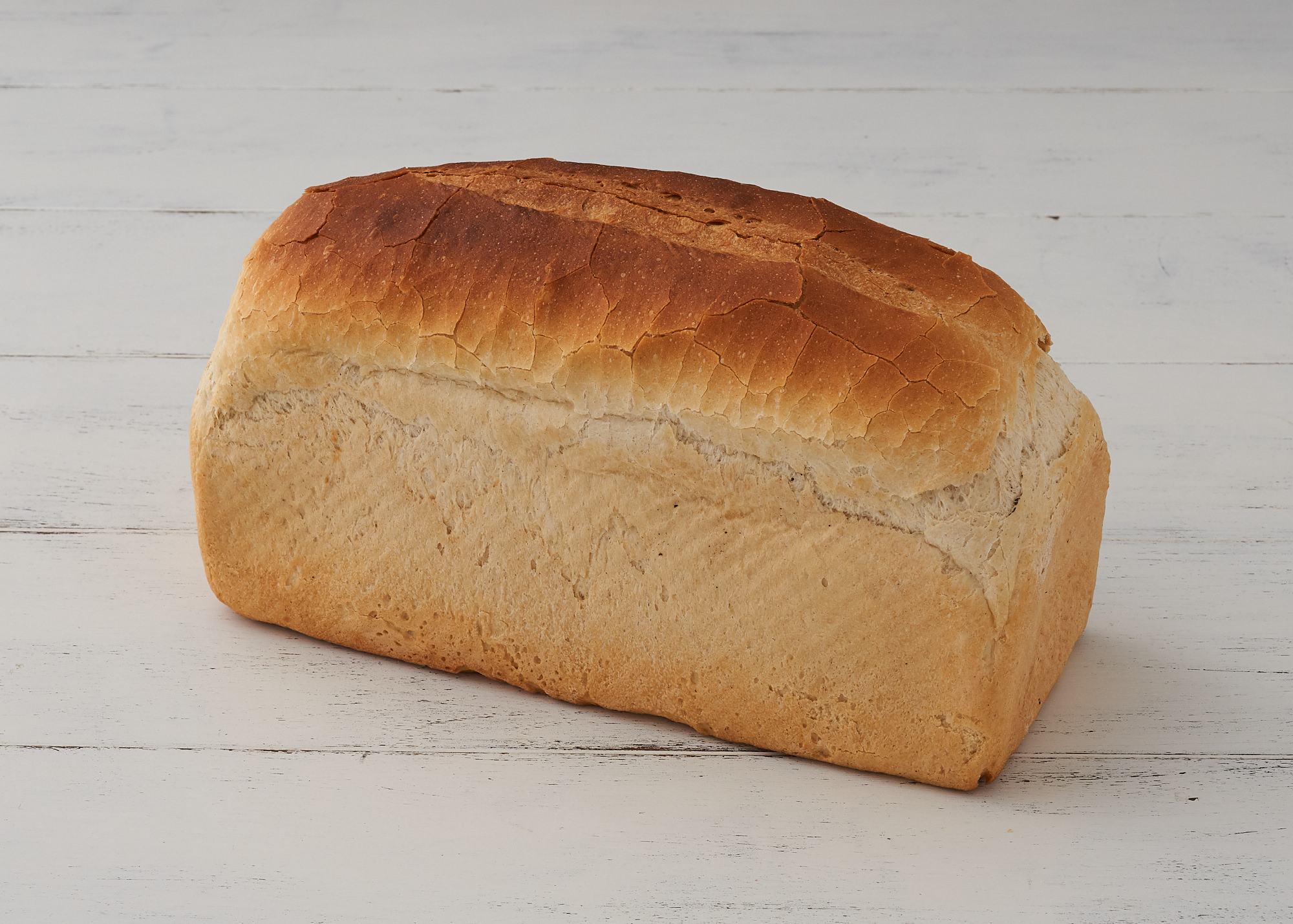 White Tin - A traditional loaf with a crusty top, excellent for sandwiches or toast.