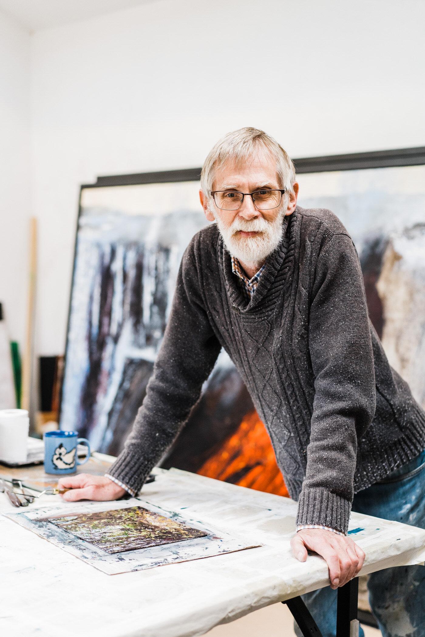 Northern Irish painter artist Maurice Orr in his studio