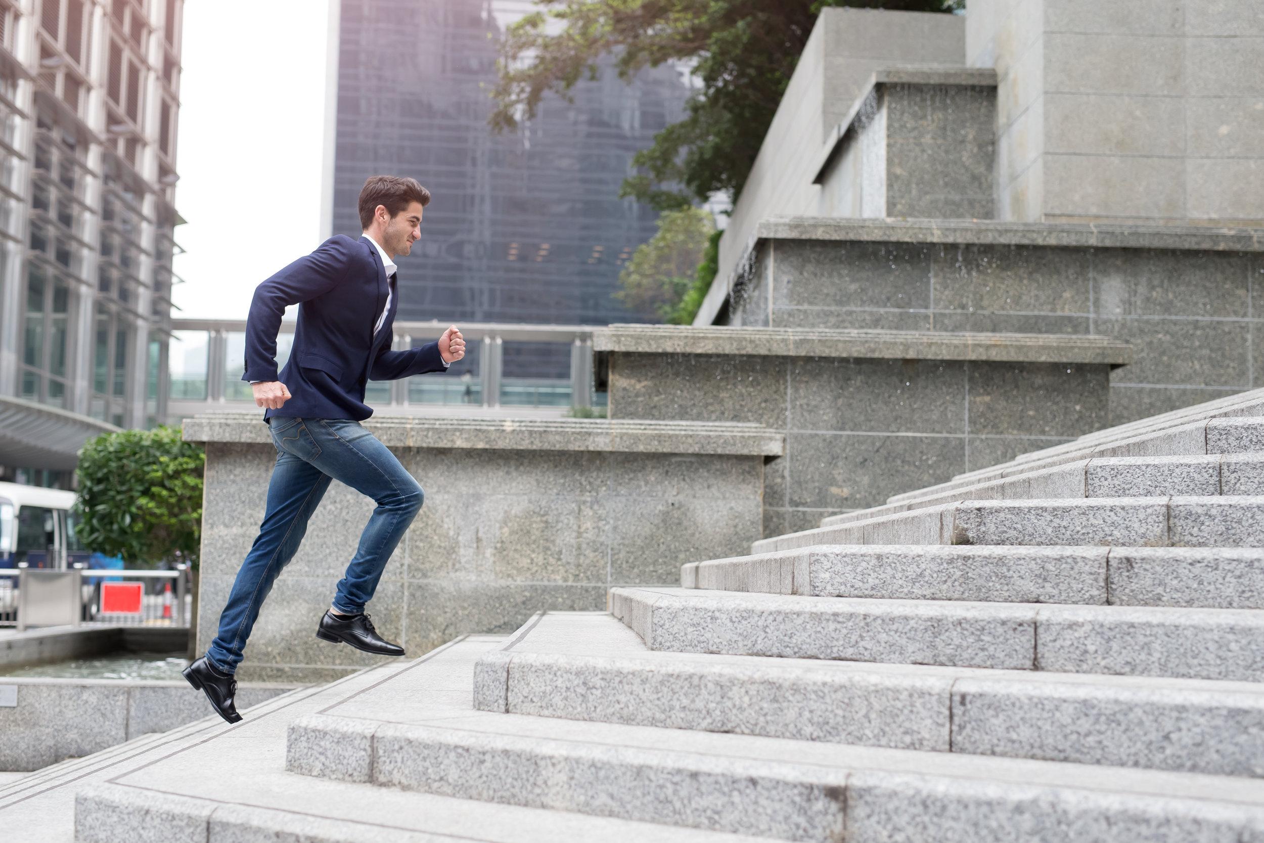 Man running up steps.jpg