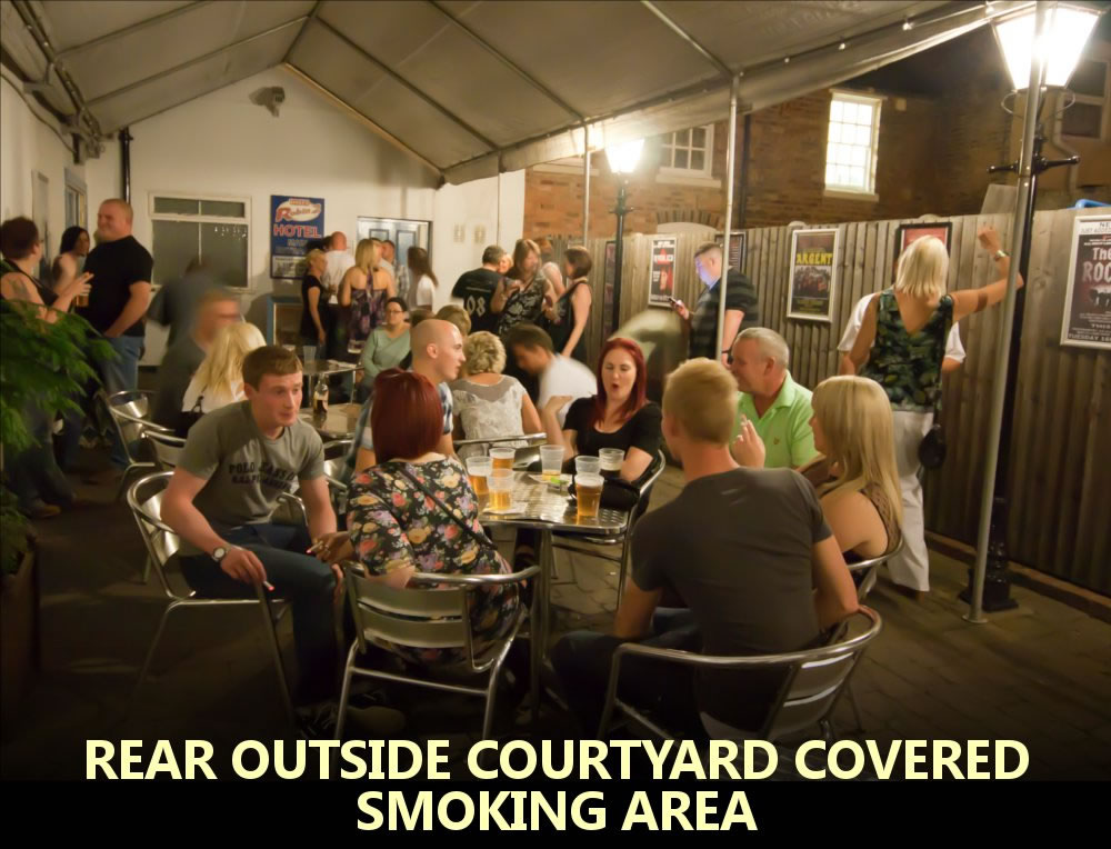 V - rear outside courtyard covered smoking area.jpg