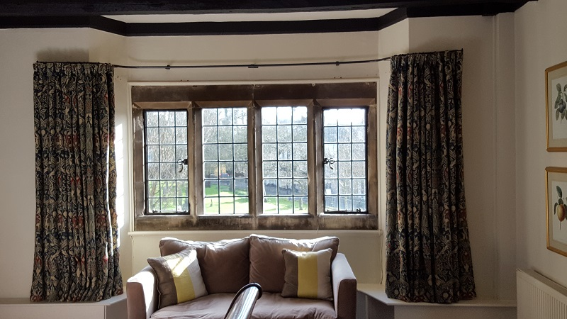 Old Bell Hotel using William Morris fabric and bent to fit curtain pole -
