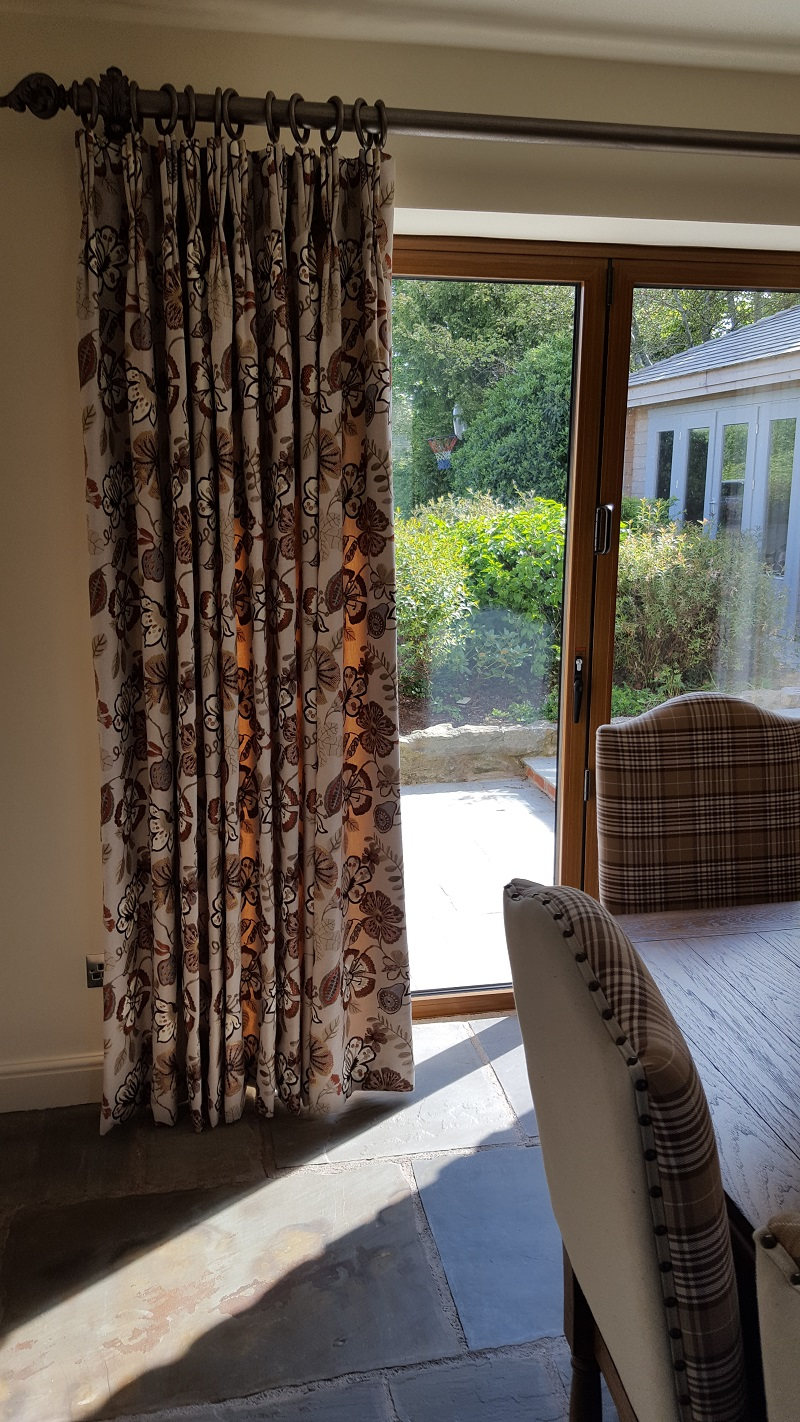 Embroidered Prestigious pinch pleat curtains with Alison Davis poles -