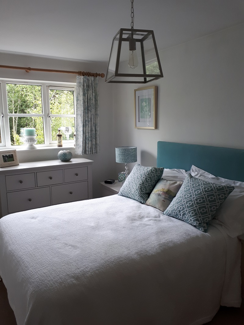 New curtains, headboard and cushions for this pretty bedroom -