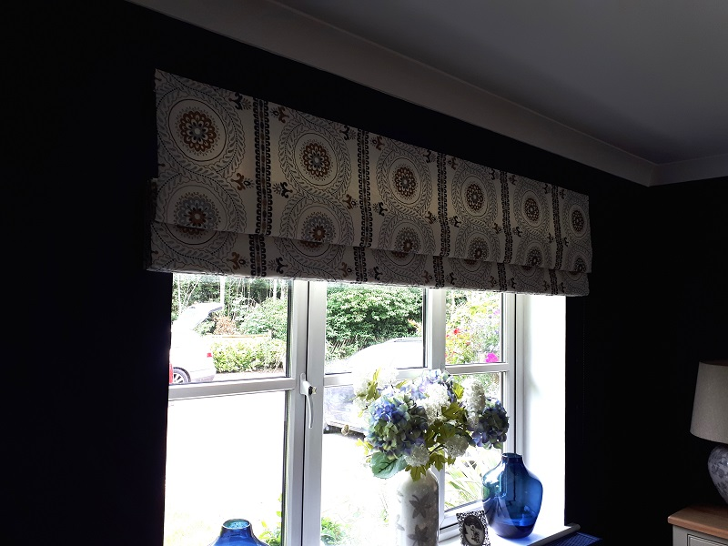 Roman blind contrasting with rich dark walls -