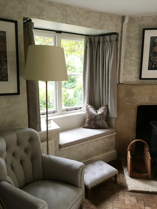 Recovered chair, window seat and new curtains for this snug -