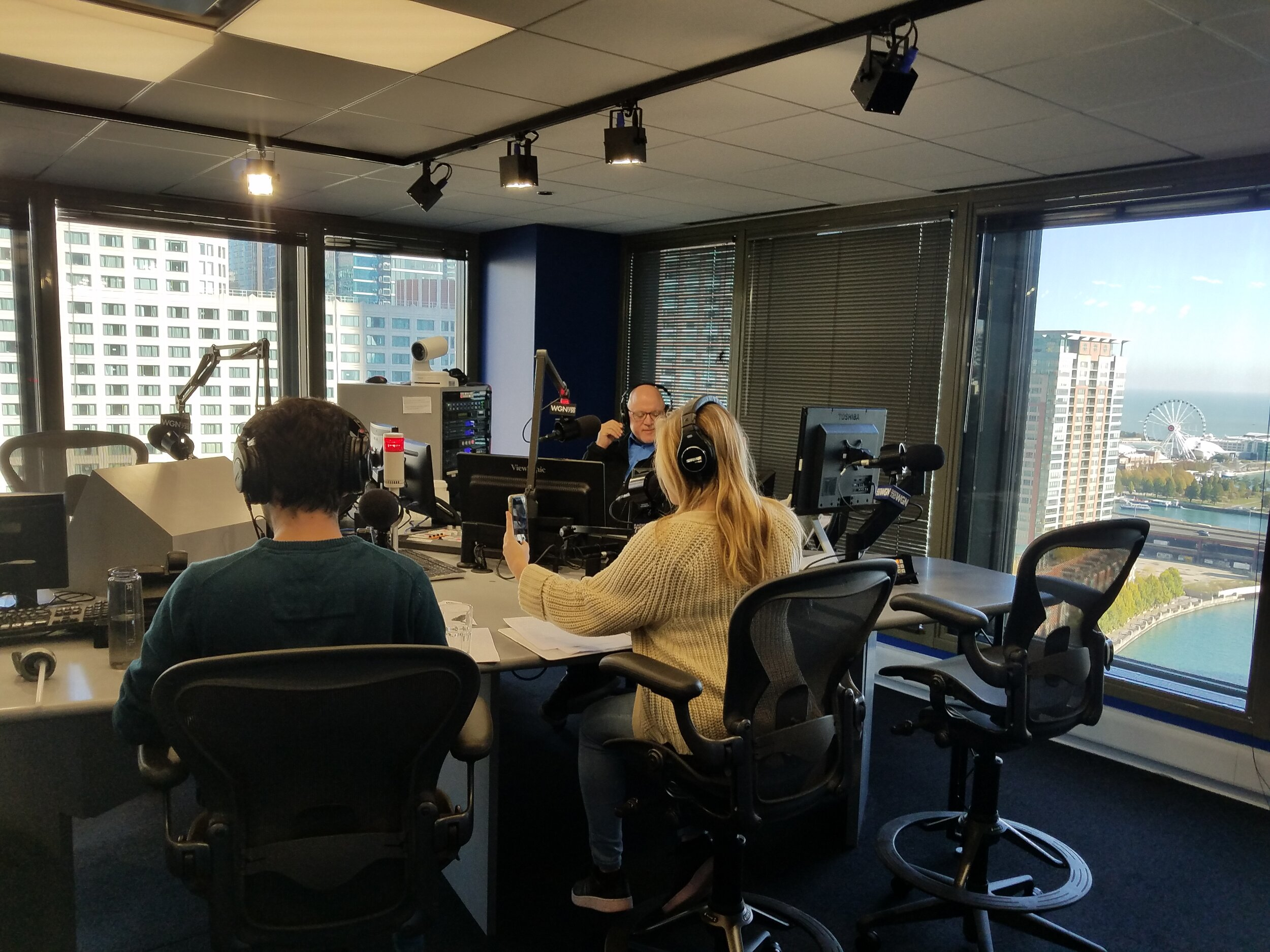 Director Corey Bradberry (L) and actor Bethany Arrington (R, posing for a selfie) speak with WGN Radio's Dean Richards.