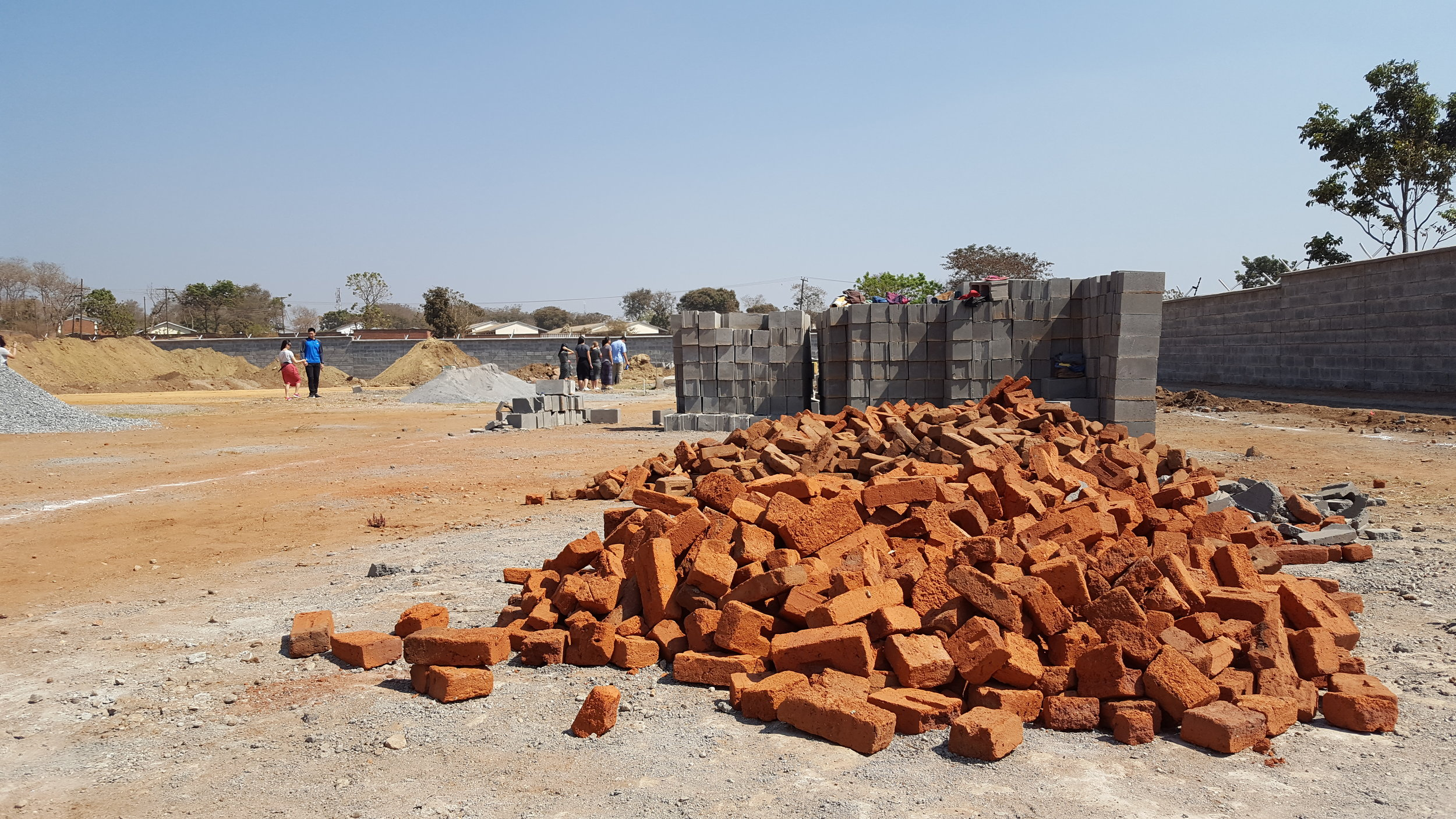 A pile of bricks lying on the ground of the construction site for CAPA's new campus.