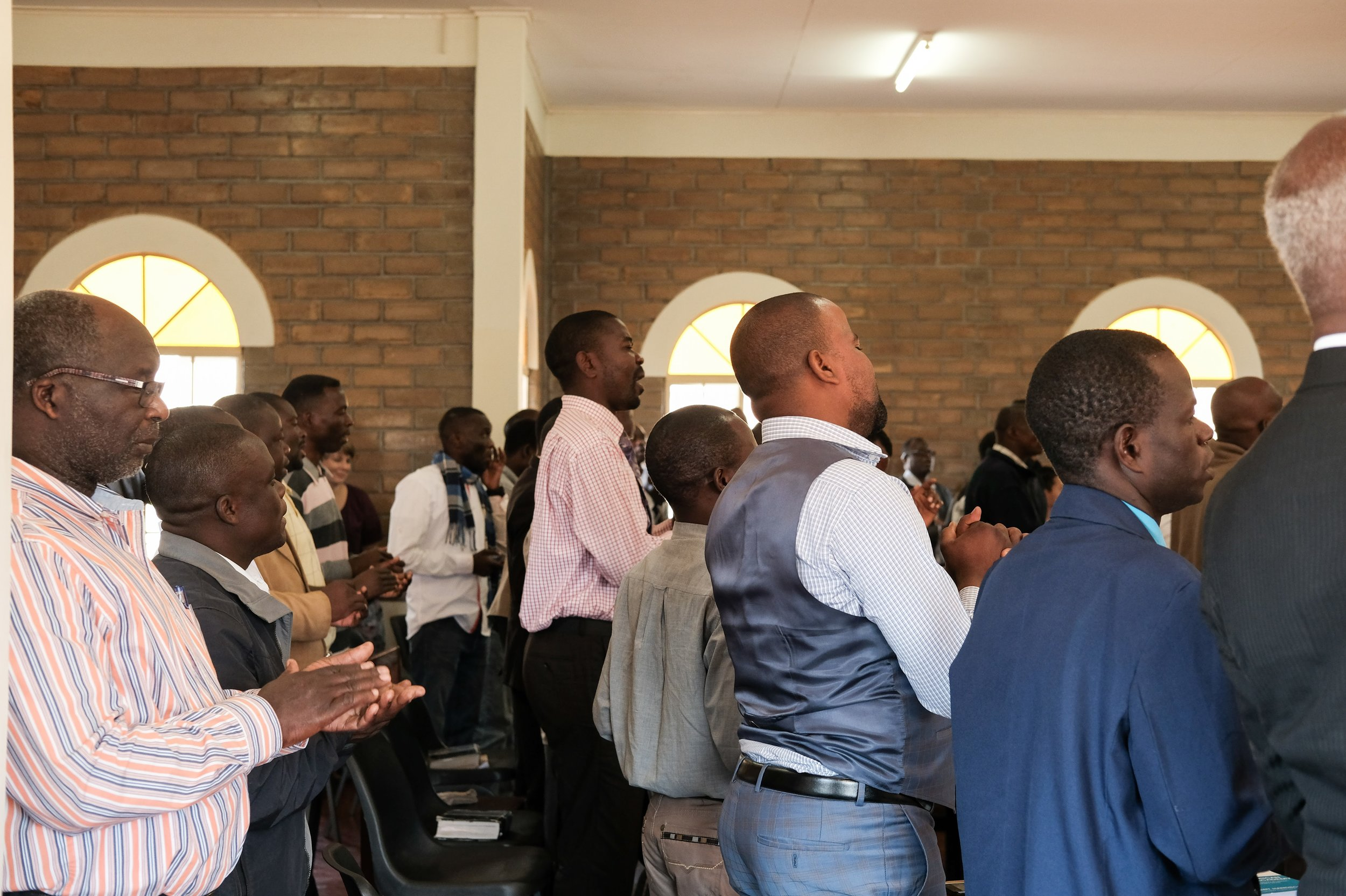 Students sing traditional Malawian worship music to praise God during chapel.