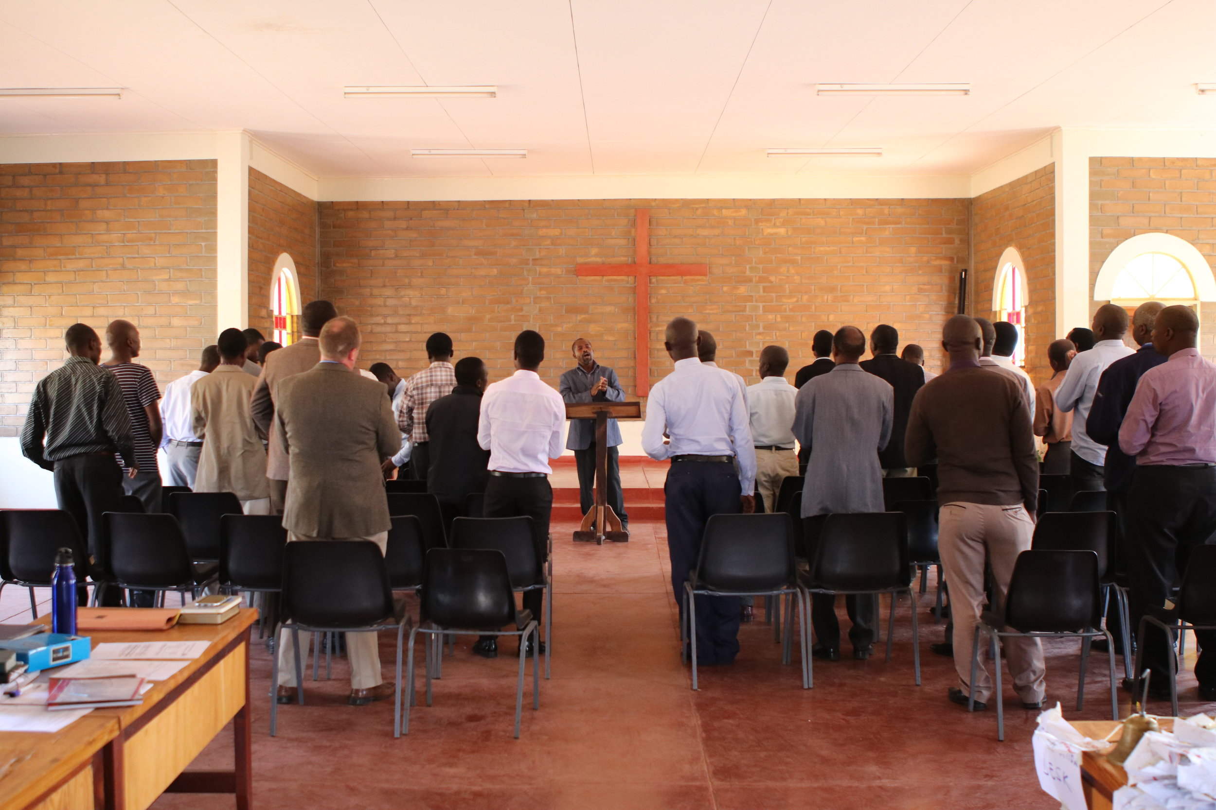 Student Daniel Mkweteza leads a time of singing and worship during chapel.