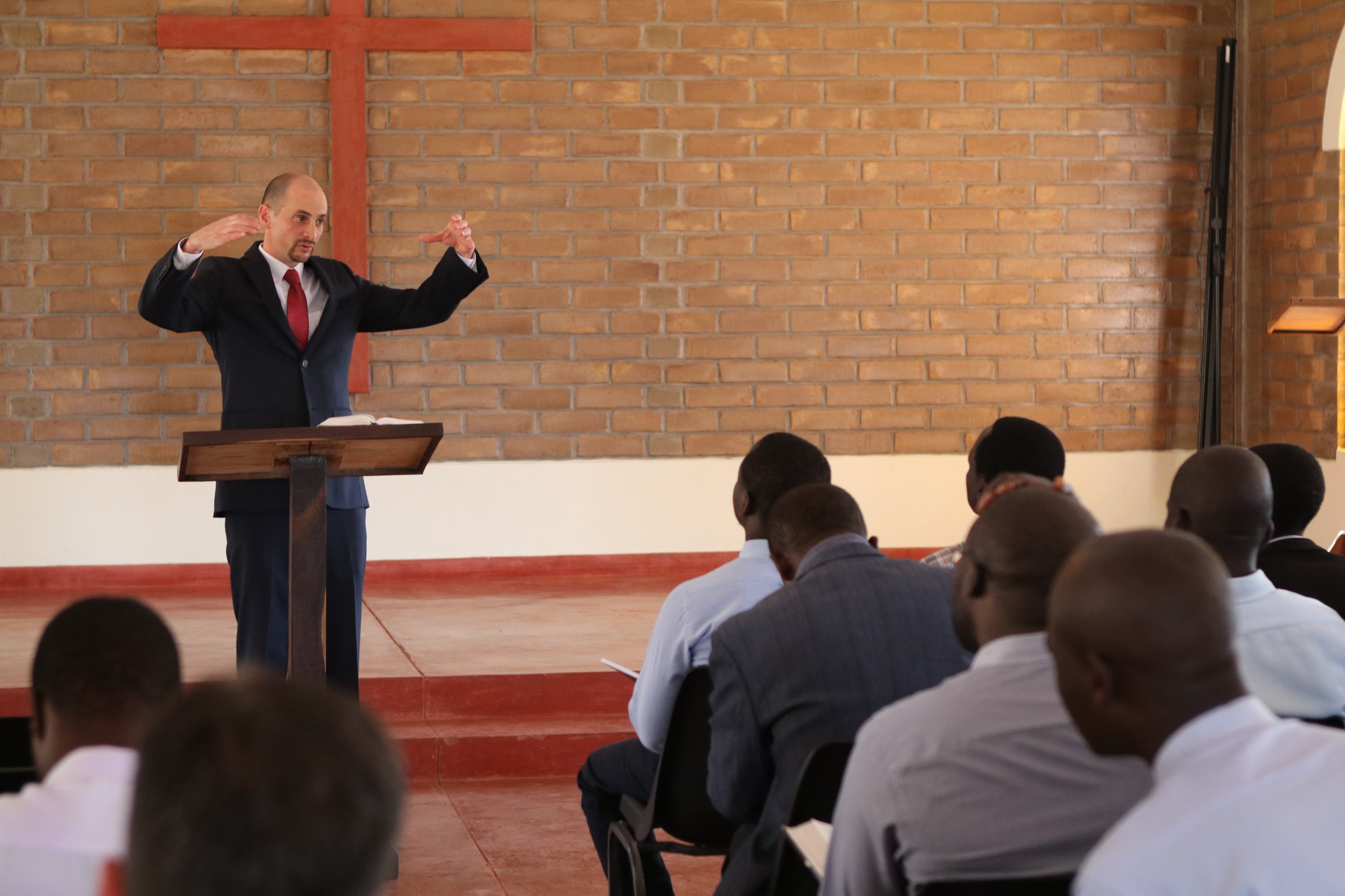 Dave Temple, then the dean of academics, preaches to students during chapel.