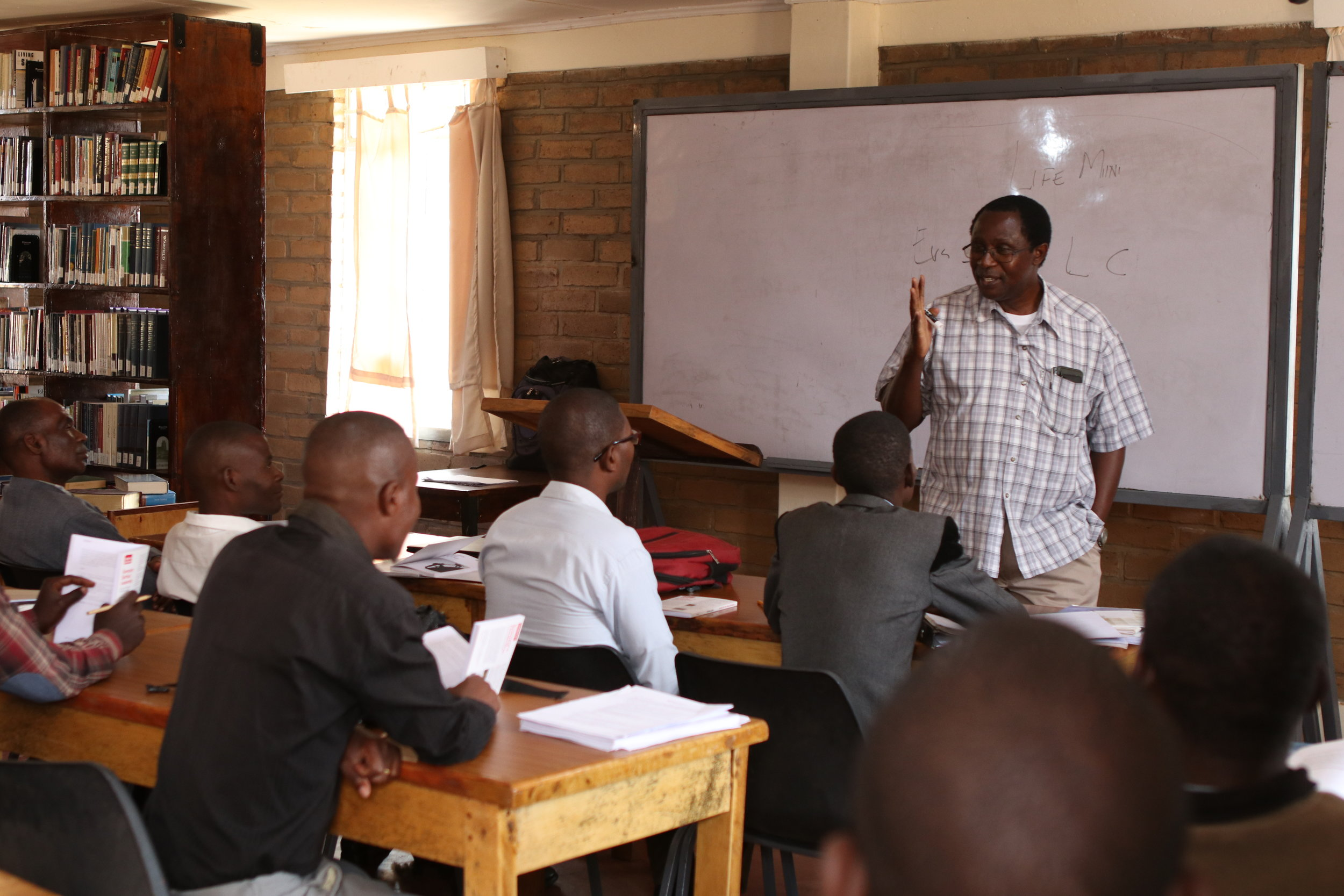 Gideon Manda, dean of students, teaches his students about the responsibilities of being a pastor.