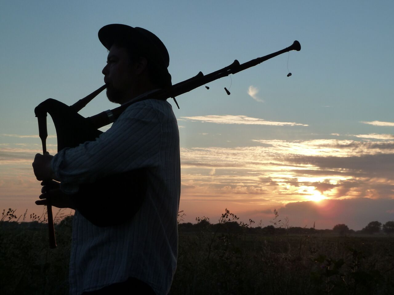 George with bagpipes sunset_preview.jpeg