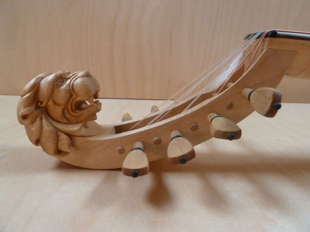 Gittern carved lion head pegbox_preview.jpeg