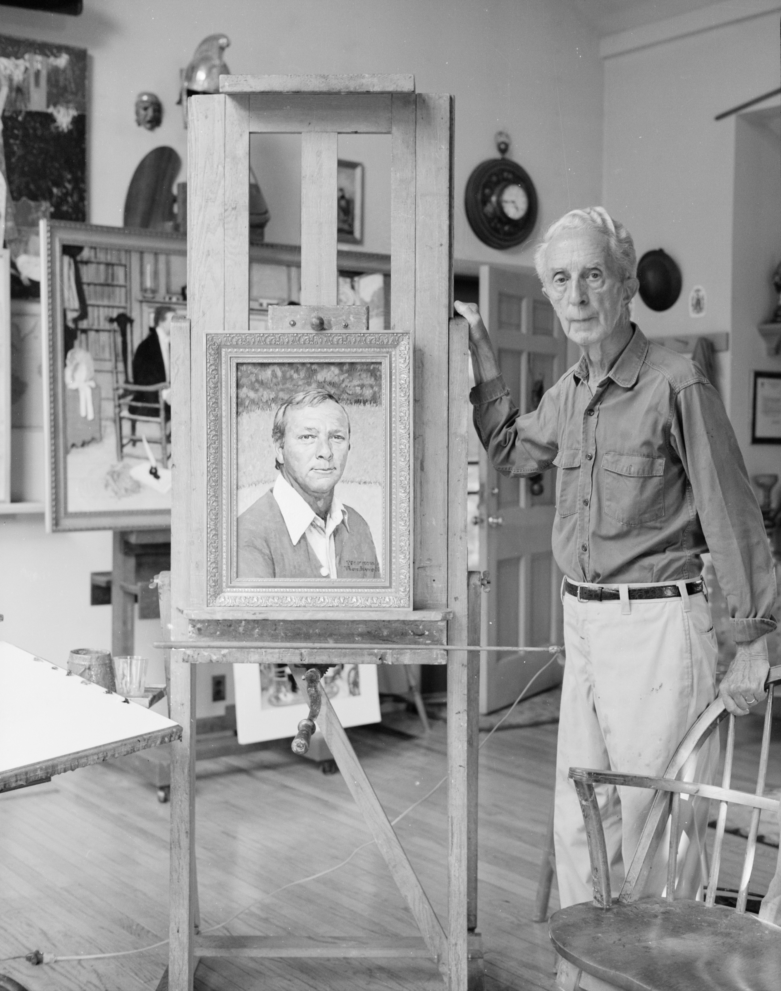 Norman Rockwell with his portrait of Arnold Palmer