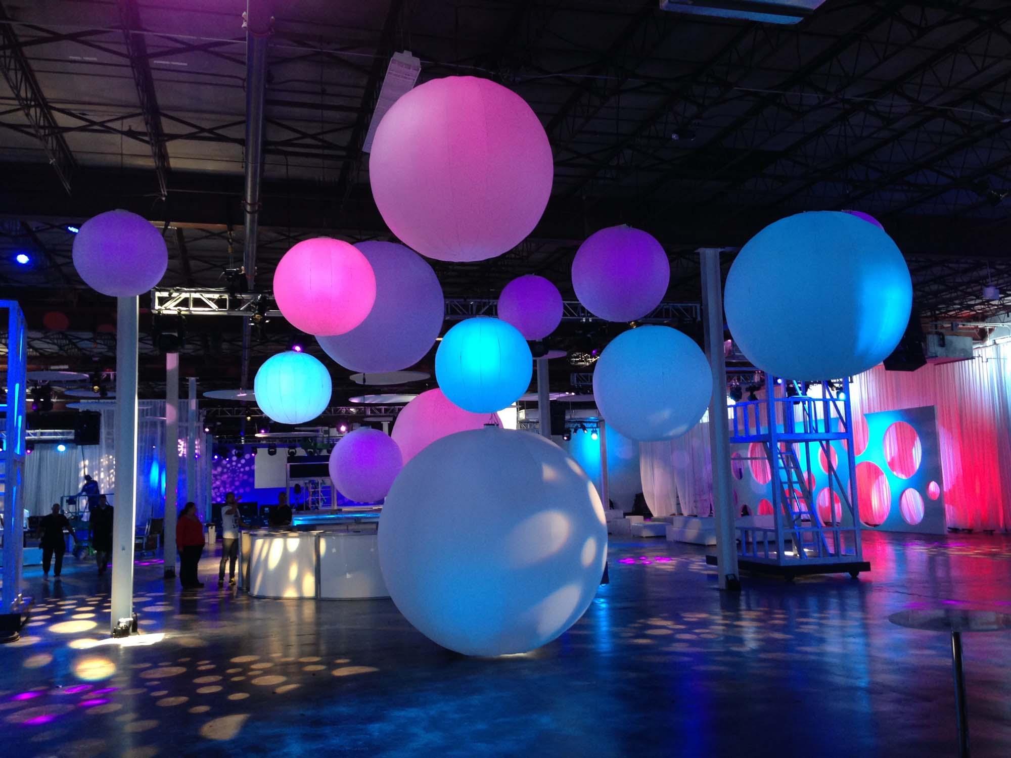 Blue, pink and purple Sphere Hi-Lights Floating in Dark Room