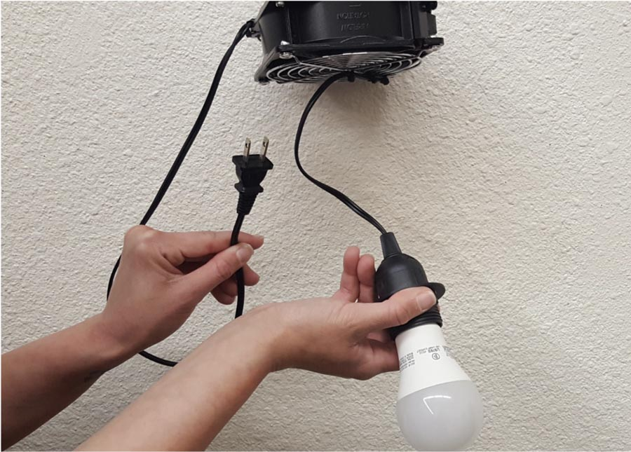 1. While unplugged, screw in the provided LED bulb(s). Plug into socket to check that the bulb and fan function properly. Then unplug.