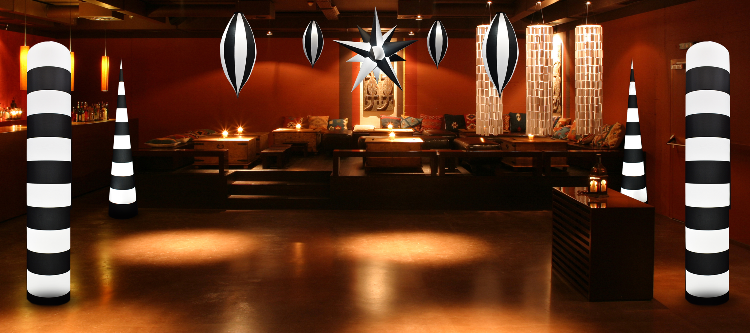AirDD Black Tie Collection decor in chic candle-lit bar