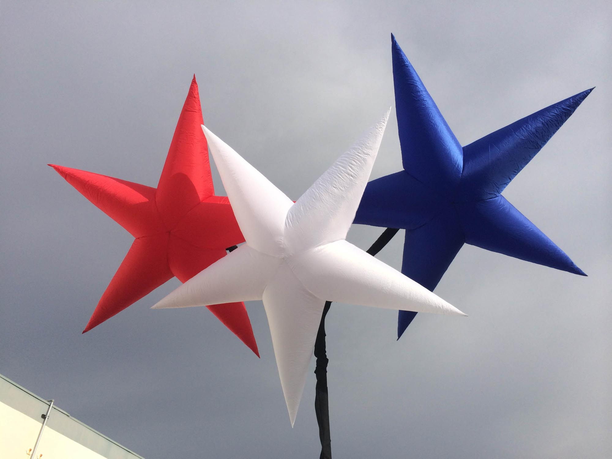 Red, White and Blue Star Hi-Lights Suspended on a Stand-Out