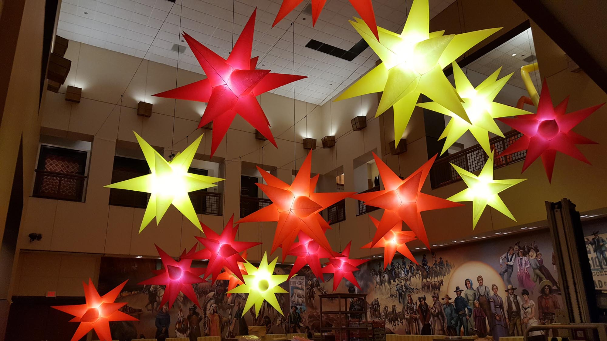 Red, Yellow and Orange Star Hi-Lights Hanging from Ceiling