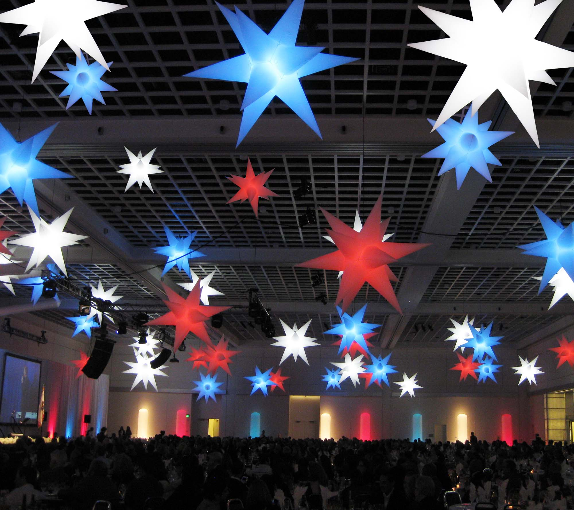 Red, White and Blue Star Hi-Lights Handing from Ceiling in a Big Room