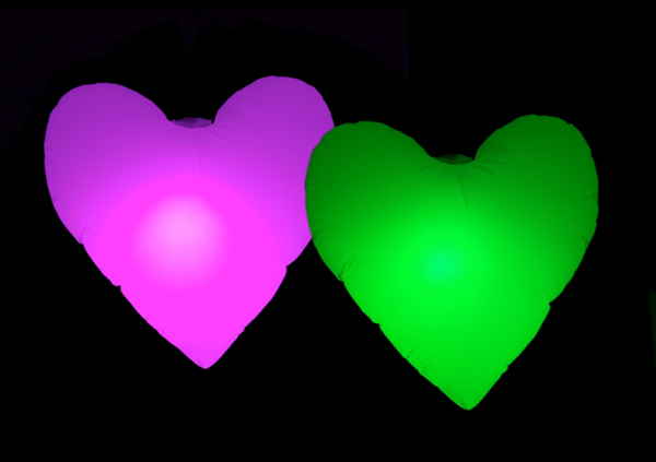 Two Heart Balloons, lit up in pink and green on a black background