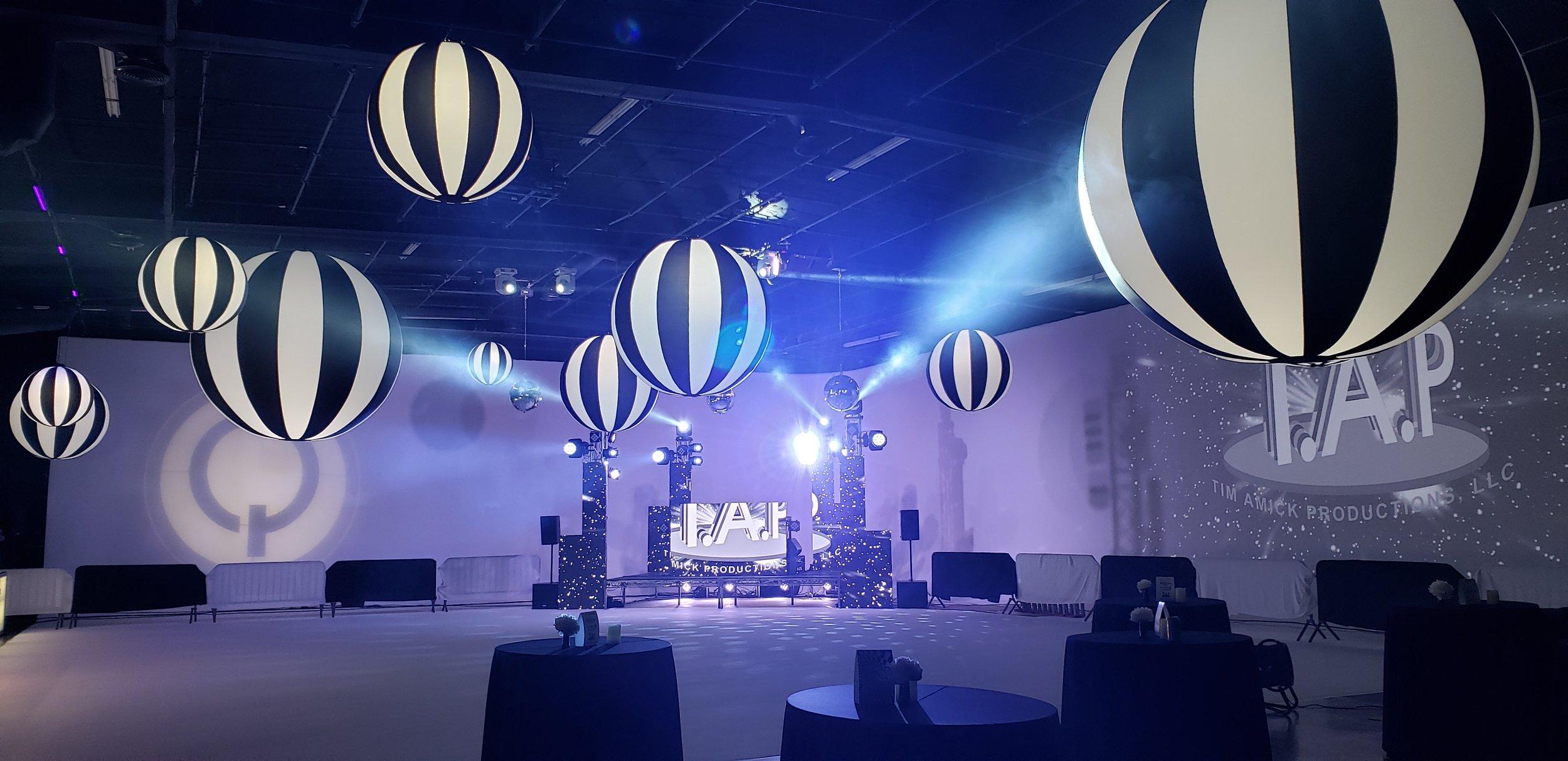 Black Tie Sphere Hi-Lights over a Dark lit Stage