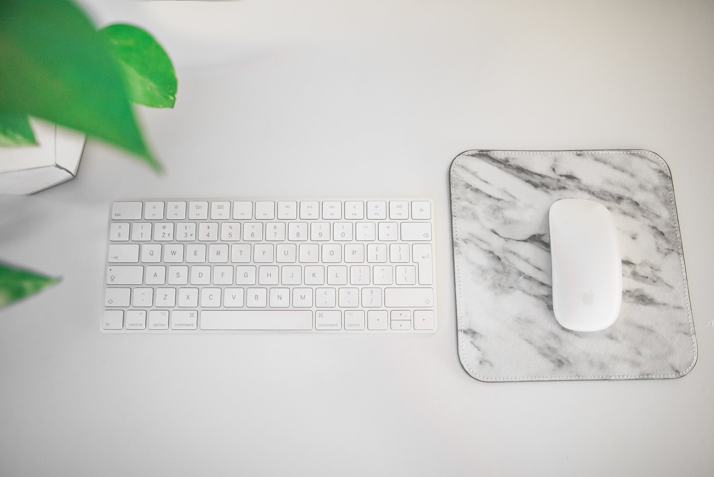keyboard and mouse on a desk
