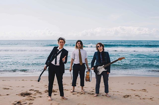 Very serious band has very serious business meeting at the beach 💼