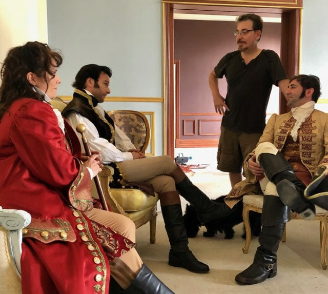 "On location, during a pre-shoot preparation for an ""In Character"" group headshot session set in 18th Century France."