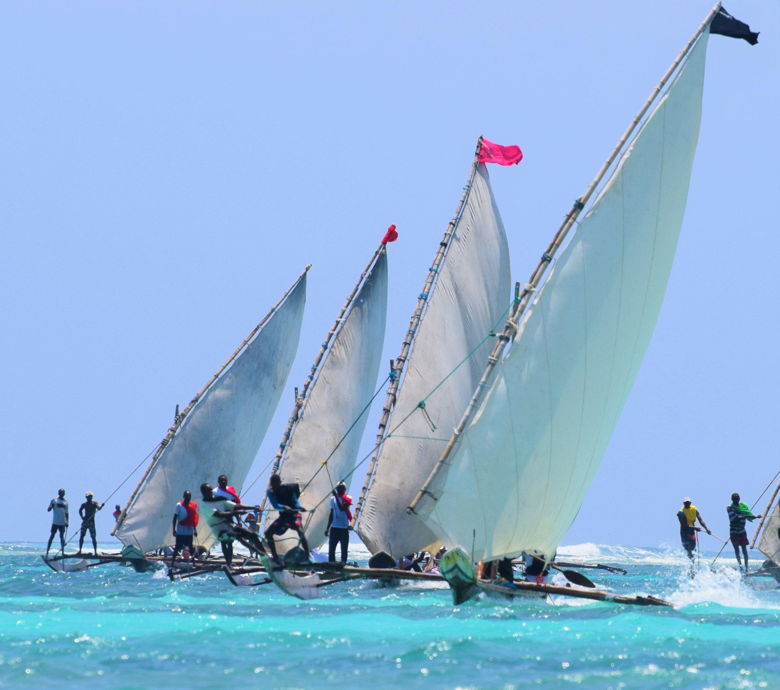 fighting for the finish line diani regatta kenya sailing race
