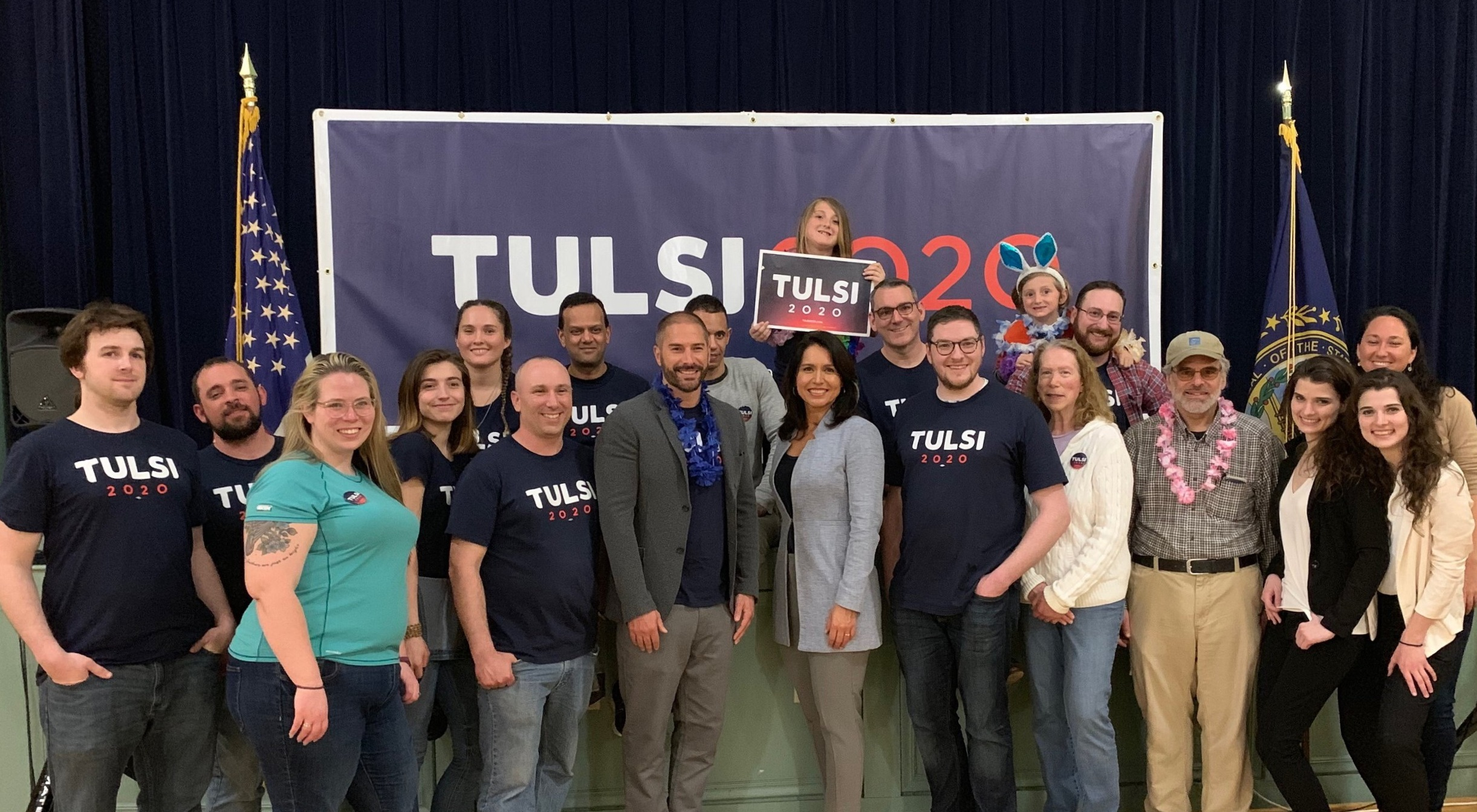 Group photo of volunteers with Tulsi after town hall event in Exeter, NH.