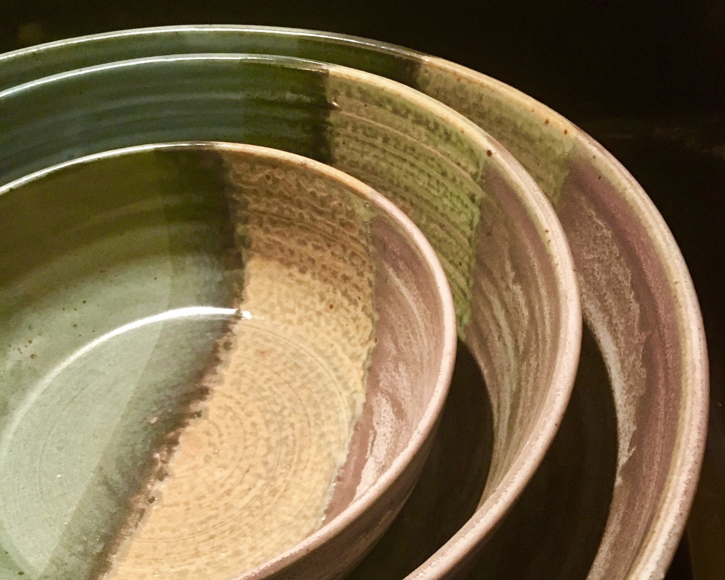 BOWLS - Starting at $24, our hand thrown bowls are fully functional and each is unique. Our berry bowl is a top seller. A set of nesting serving bowls can complete any busy household kitchen.