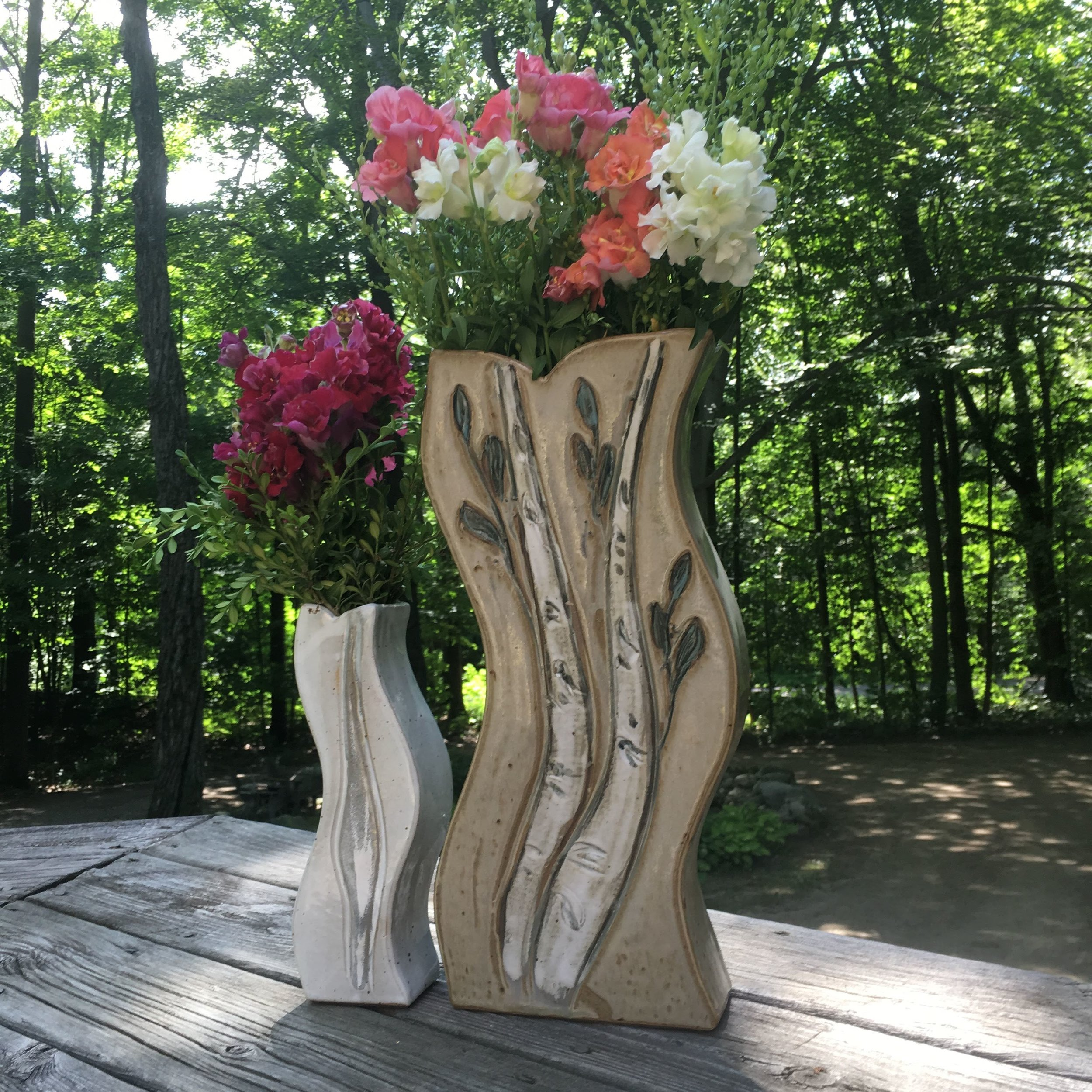 VASES - Starting at $28, each home and occasion calls for a unique style of vase. Inspired by locally grown flowers, we hand-piece and wheel-throw vases of all sizes and shapes.