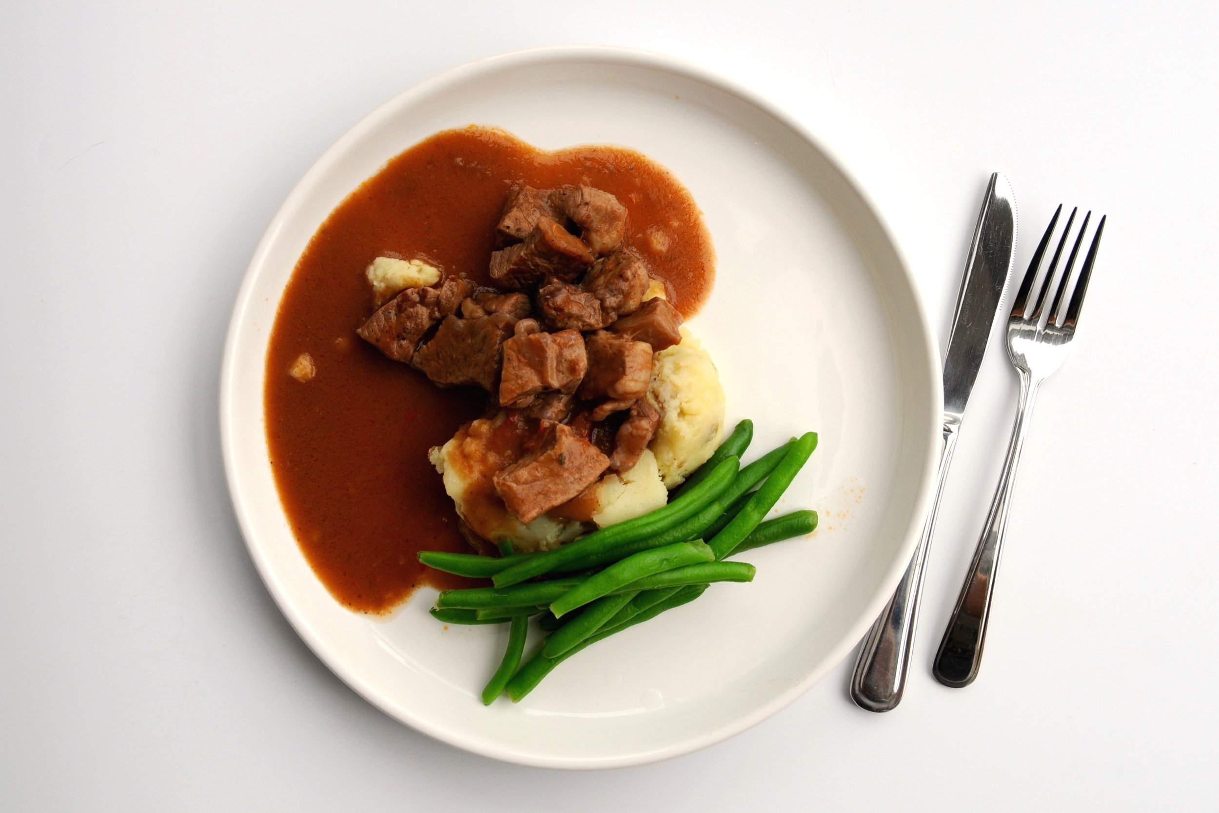 Red wine braised beef with whipped dairy-free mashed potatoes, and green beans.