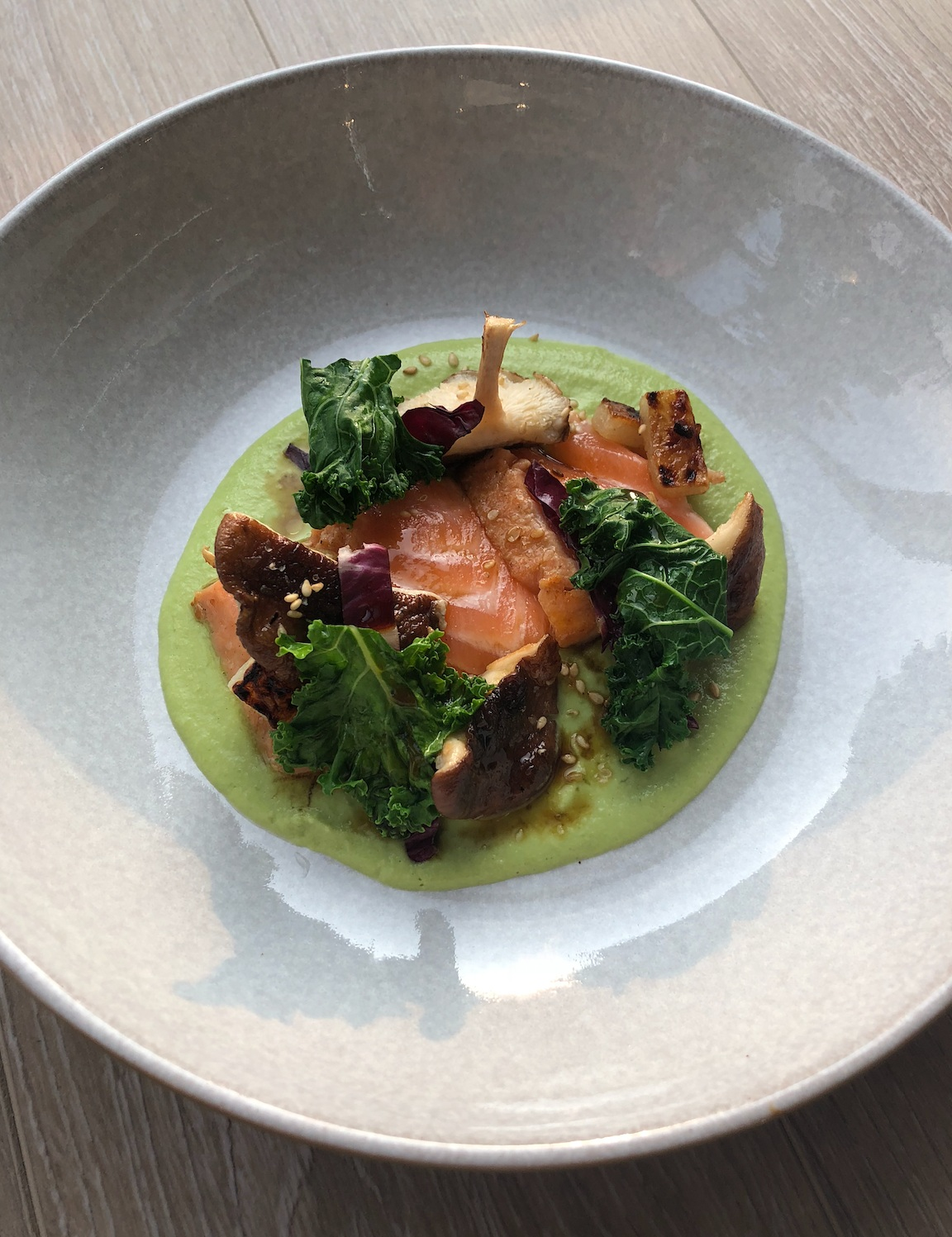 Tataki Maple Soy Glazed Salmon with Smoked Mushrooms and Blanched Radicchio over Green Apple Puree.