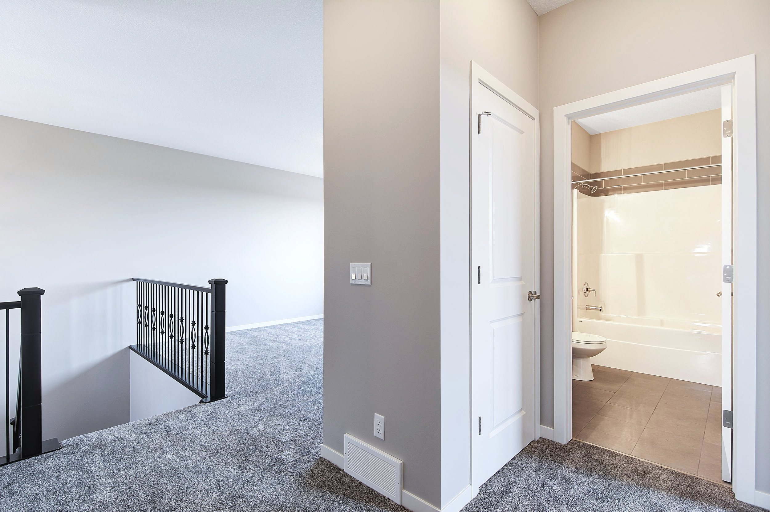23-upper view into bathroom and bonus room-1.jpg